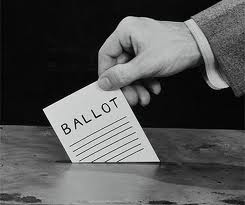 voter placing ballot