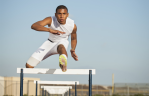 man jumping hurdles