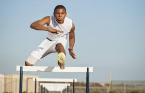 man jumping hurdles